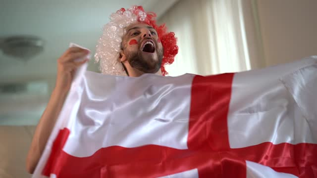 english fan celebrating at home - loft apartment stock videos & royalty-free footage