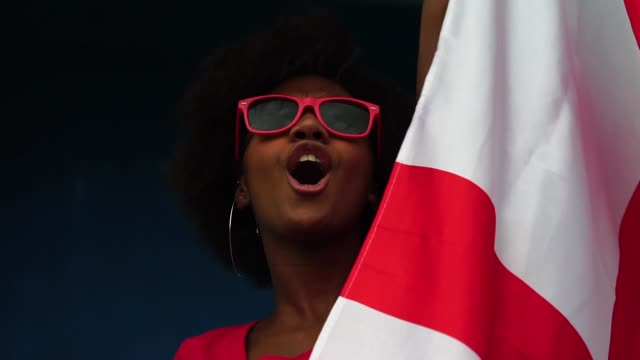 english fan watching a soccer game - fan enthusiast stock videos and b-roll footage