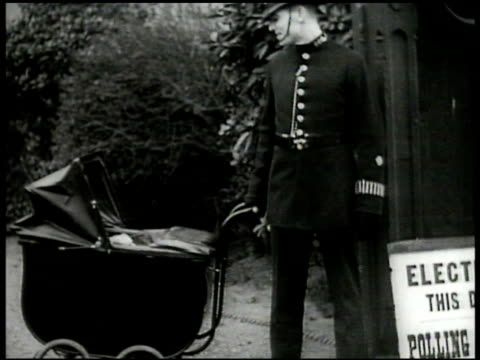 english men entering polling stations to vote. policeman watching baby carriage. int woman voting, ballot box. night: ext vs crowds cheering on... - ballot box stock videos & royalty-free footage