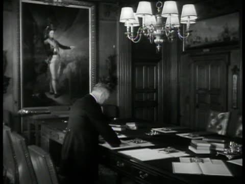 vídeos de stock, filmes e b-roll de english men walking in corridor. man standing at table. organizing ink tray. man preparing long table. assistant world war ii wwii navy london - 1930 1939