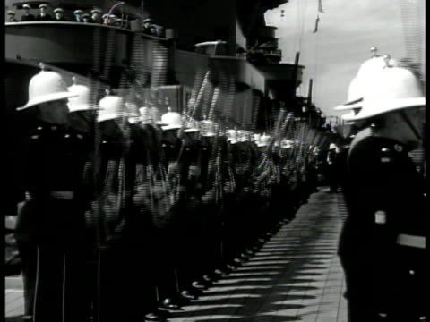 english naval officer boarding ship men saluting. soldiers w/ rifles at attention on ship deck. vs destroyer ships at sea. navy world war ii wwii - military ship stock videos & royalty-free footage