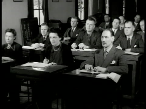 english police students in classroom instructor w/ ear charts. vs students at desk woman taking notes. ext students standing on field 'suspects' w/... - 1949 stock videos & royalty-free footage