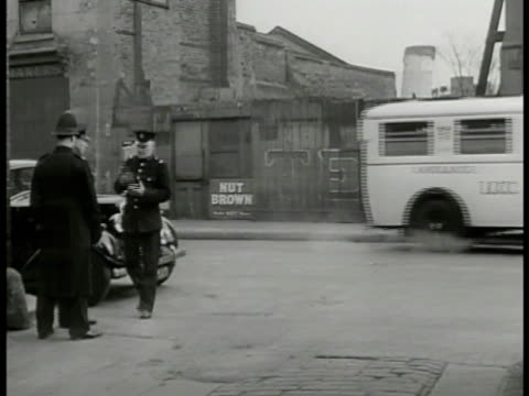 english policemen cars on street longgrill car pulling up to curb 'lt roberts' and 'inspector finch' exiting talking to policemen detective - 1949 stock videos and b-roll footage
