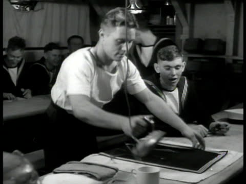 english sailors studying books at table ms sailor ironing clothes ext ms two naval officers walking on deck int ms statue of admiral horatio nelson... - marine stock-videos und b-roll-filmmaterial