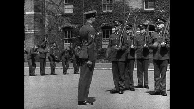 english soldiers in mess hall eating ext ws soldiers doing drill ms officer correcting soldier w/ rifle ws soldiers dropping into firing position on... - 1939 stock videos & royalty-free footage