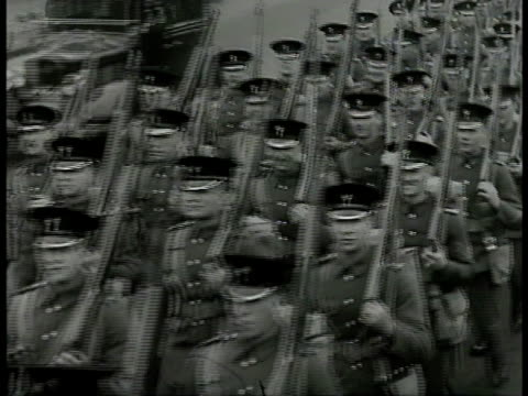 english soldiers marching in formation on street. vs british pilots strapping gear on, fighter airplanes on field bg. sign 'gas mask distributions.'... - forze armate britanniche video stock e b–roll