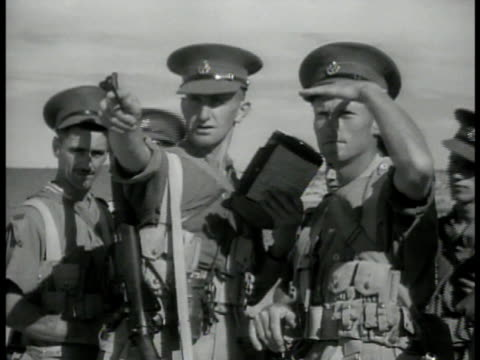 english soldiers marching on desert ms soldiers pointing ws ships in harbor suez canal ws soldiers raising flag signals ws destroyer ship in harbor... - suez canal stock videos and b-roll footage