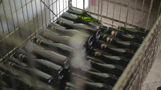 english sparkling wine bottles being unloaded - crate stock videos & royalty-free footage