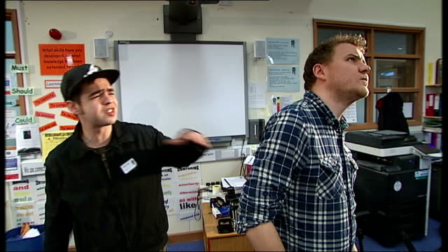 english teacher takes part in rap battles against teenagers ext mark grist interview with reporter in shot sot grist and students in classroom... - schlacht stock-videos und b-roll-filmmaterial