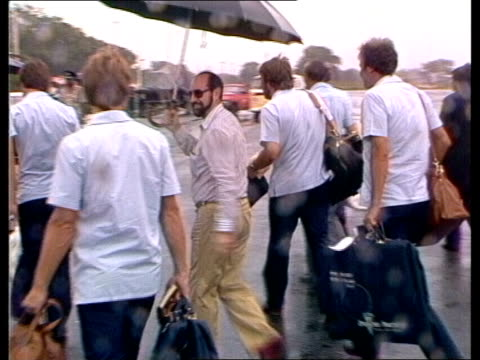 english team arrive in guyana; west indies: georgetown guyana plane lands l-r puddle and rain ian botham and others r-l across tarmac escorted by man... - guyana stock videos & royalty-free footage