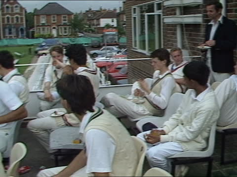 ted dexter report:; england: london: kennington: oval cricket ground: ext bv players lying on pitch doing exercises tcms england player doing sit-ups... - oval kennington stock videos & royalty-free footage
