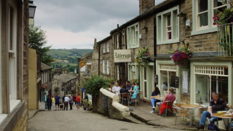 english tourists on cobbled street - english culture stock videos & royalty-free footage