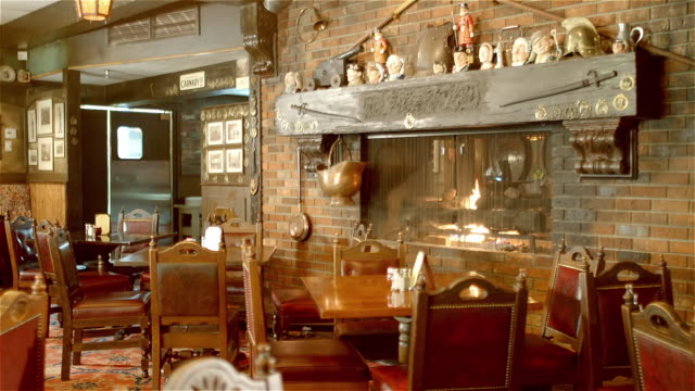 ws ts english traditional style restaurant dining room with fireplace and grandfather clock - abandoned stock videos & royalty-free footage