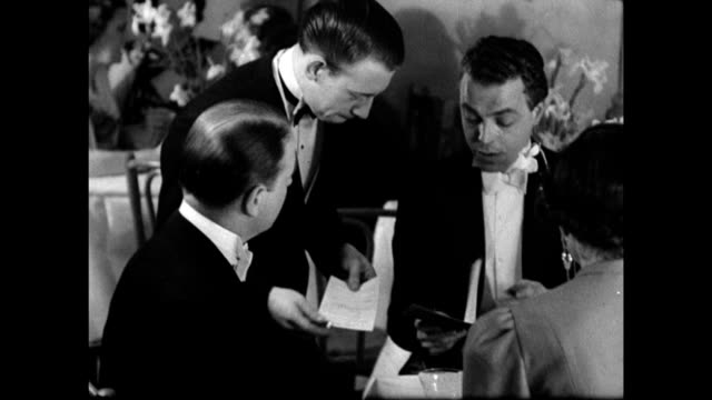english waiter taking order of whiskey & gin 'will you sign an order form, sir? date it yesterday, you had to order it in advance.' england - formal stock videos & royalty-free footage