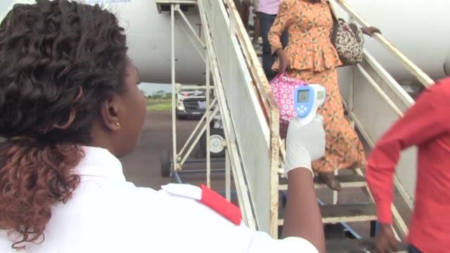 vídeos de stock, filmes e b-roll de enhanced ebola screenings are rolled out at mbandaka airport in the democratic republic of congo - ébola