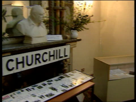 milton keynes bletchley park churchill display at centre pan to empty display case tcms empty space in display case pan to literature beside - enigma machine stock videos & royalty-free footage
