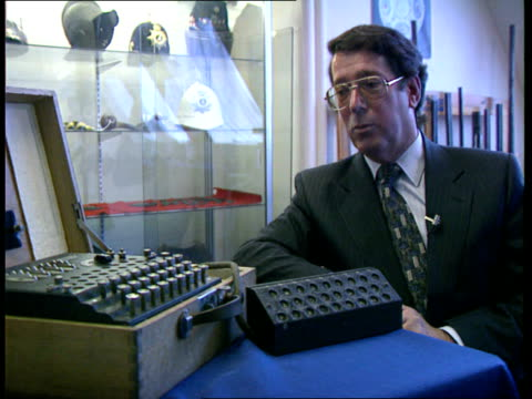 enigma sold intlondon new bond st phillips auctioneers tcms enigma encoding machine cs fingers tapping keys on machine cms letters flashing on... - enigma machine stock videos & royalty-free footage