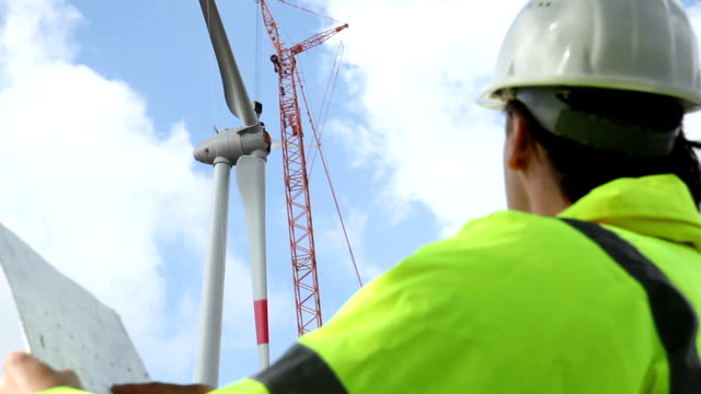 enigneer pointing at new wind turbine - design stock videos & royalty-free footage