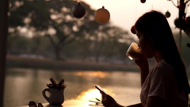 enjoy drink silhouette woman - coffee drink stock videos & royalty-free footage