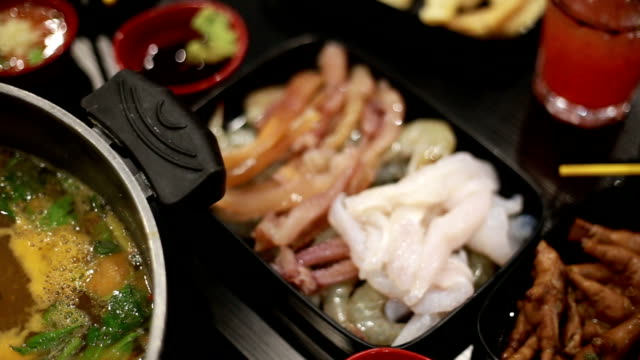 Enjoy eating Shabu Shabu and Sukiyaki in hot pot