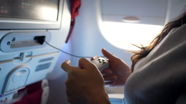 enjoy gaming on flight - instructions stock videos & royalty-free footage