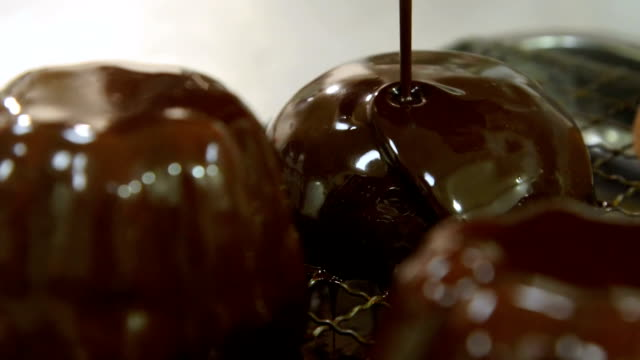 enjoy in chocolate in super slow motion - decorating stock videos & royalty-free footage