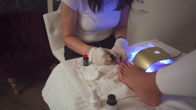 i enjoy in my beautician work and satisfied customer is my goal - massage table stock videos & royalty-free footage