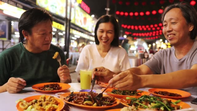 enjoy street food - malaysia stock videos & royalty-free footage