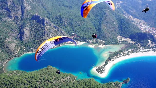 enjoy the paragliding in oludeniz. - paragliding stock videos & royalty-free footage