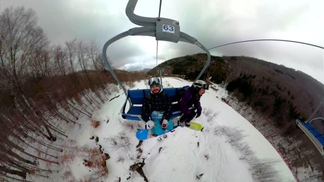 enjoy the winter! - inquadratura dalla sciovia video stock e b–roll