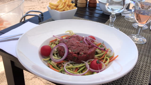 Enjoy your tartare steak at beach!