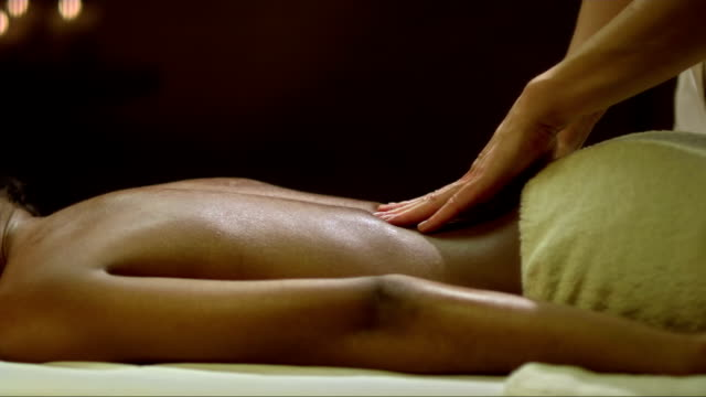 enjoying a back massage - massage table stock videos & royalty-free footage