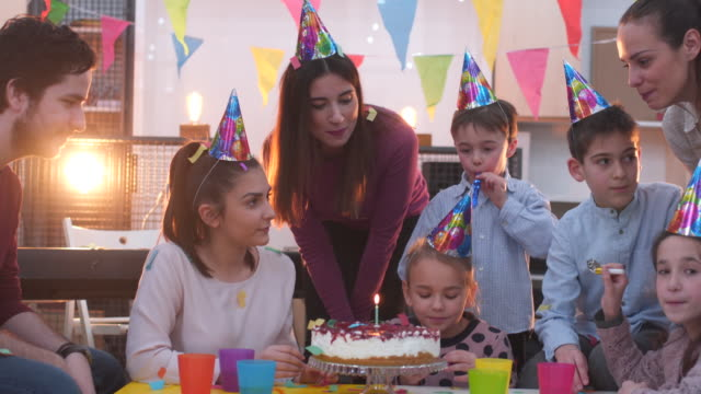 enjoying a birthday party - party hat stock videos & royalty-free footage