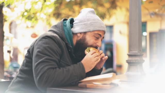 Enjoying a burger outdoors.