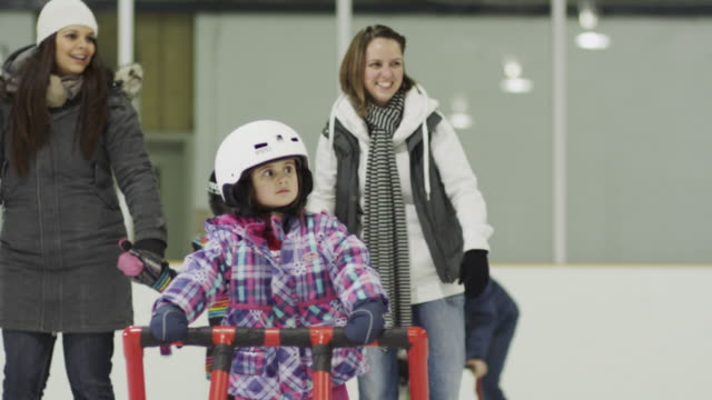 enjoying a day at the ice skating rink - ice rink stock videos and b-roll footage