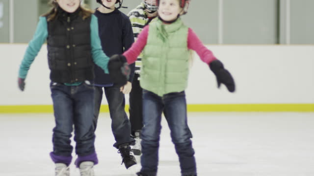 enjoying a day at the ice skating rink - ice skating stock videos & royalty-free footage