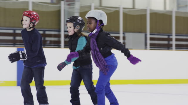 enjoying a day at the ice skating rink - ice rink stock videos & royalty-free footage
