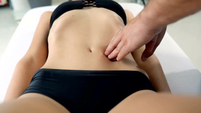 enjoying a day at the spa.abdomen - chiropractic adjustment stock videos & royalty-free footage