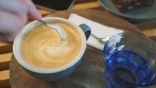 enjoying a delicious cup of coffee. - spoon stock videos & royalty-free footage