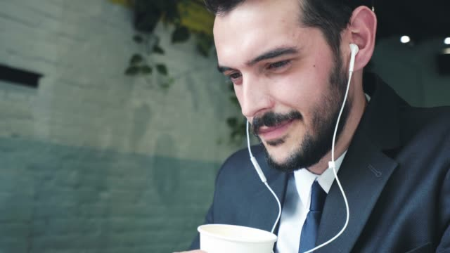 Enjoying a good coffee while using headphones.