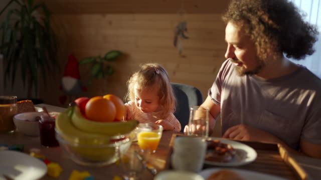 enjoying a wholesome breakfast with dad - healthy lifestyle stock videos & royalty-free footage