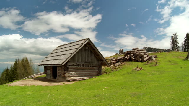 hd: enjoying alpine life - log cabin stock videos & royalty-free footage