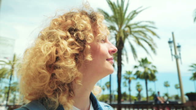 enjoying barcelona city life. - curly hair stock videos & royalty-free footage
