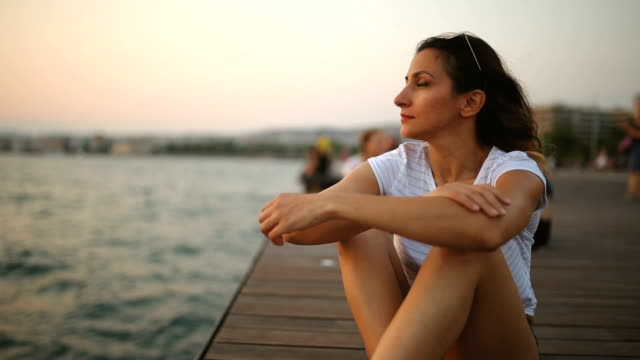 enjoying by the sea - contemplation stock videos & royalty-free footage