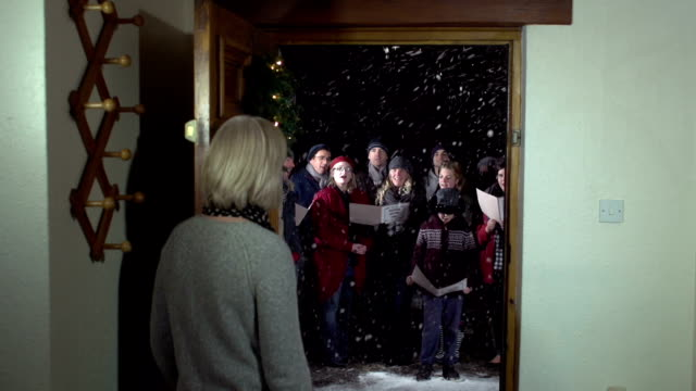 Enjoying Christmas Carol Singers from the House front door
