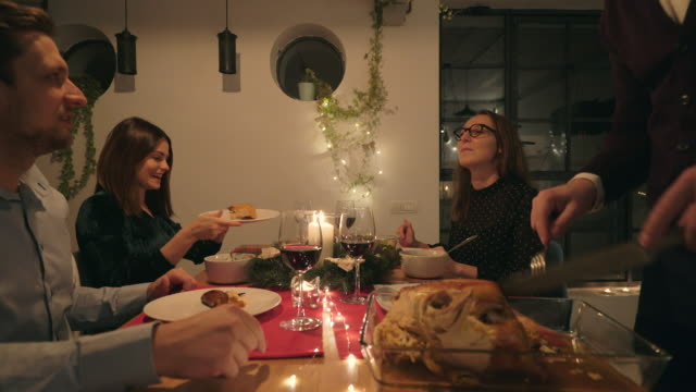enjoying christmas dinner together. - dining table stock videos & royalty-free footage