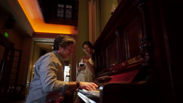enjoying classic music like couple - pianist stock videos & royalty-free footage