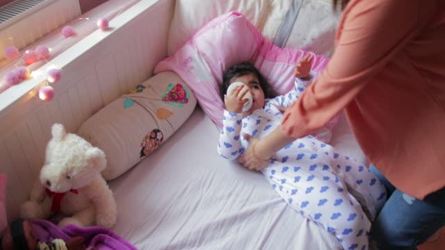 enjoying her bottle of baby formula - human limb stock videos & royalty-free footage