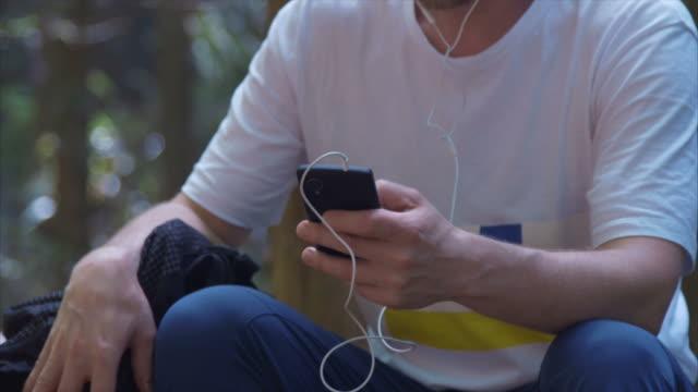 enjoying music in nature - bag stock videos & royalty-free footage