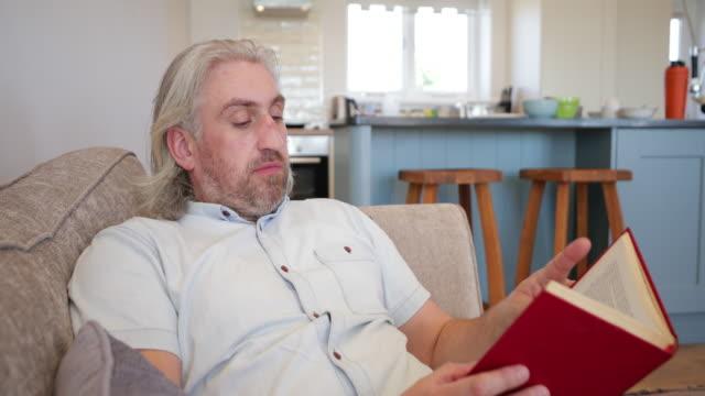 enjoying reading a book - literature stock videos & royalty-free footage